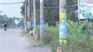 """Cột điện """"nở hoa"""" trên tuyến đường dọc sông Đà"""